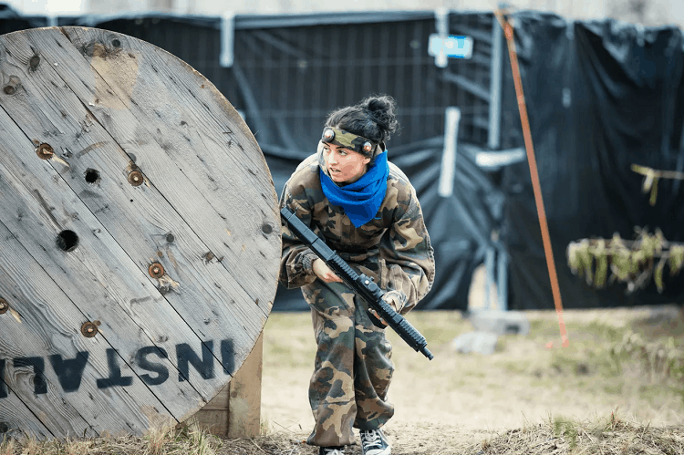 Woman On Airsoft Field