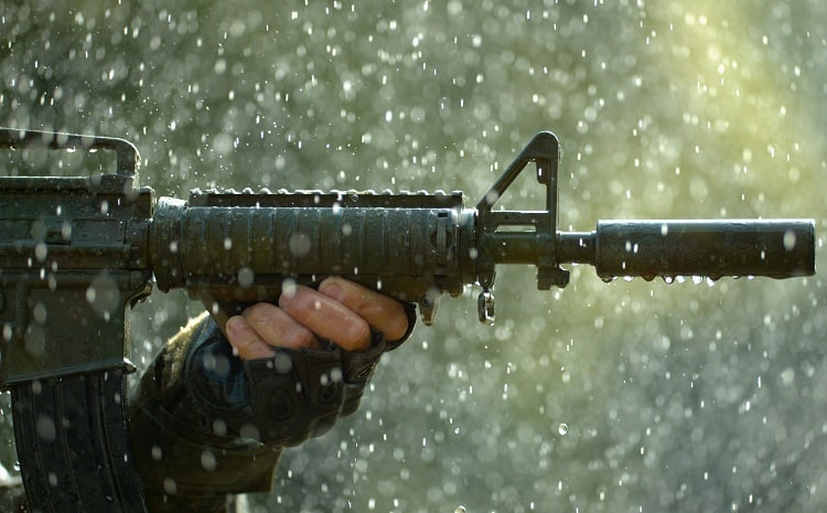 Holding Rifle In The Rain